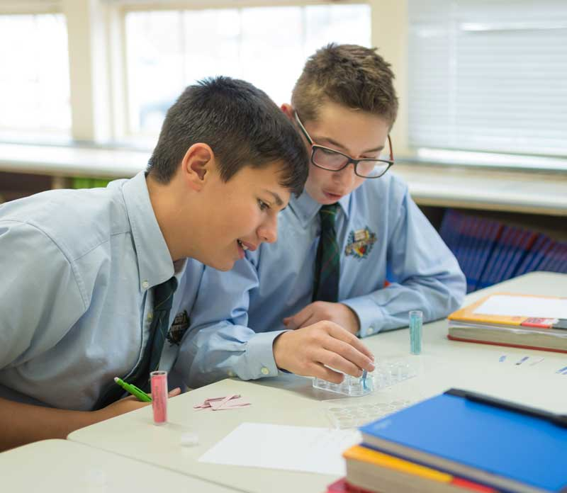 teen boys having discussion in class
