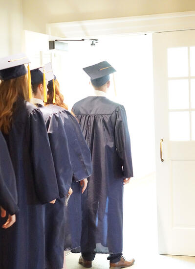 graduation-standing-at-door