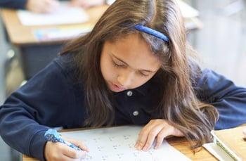 grammar student doing math