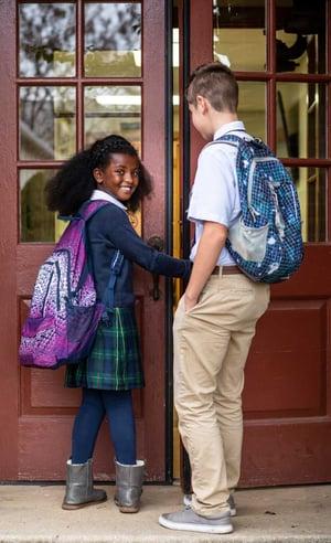 kids-backpacks-at-door